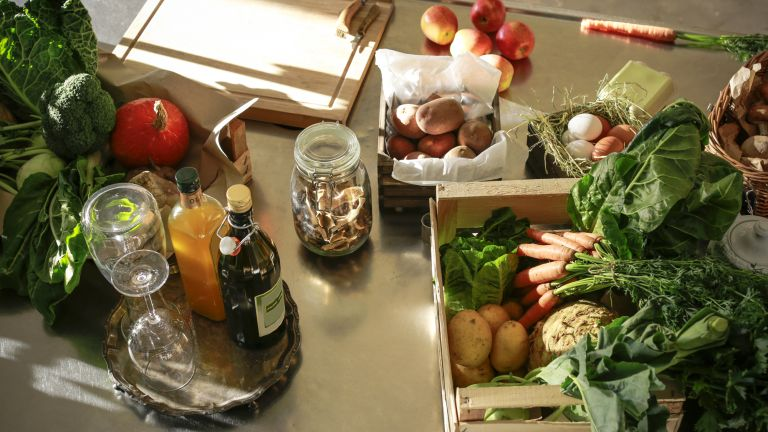 Fruit and vegetables displayed on a kitchen counter
