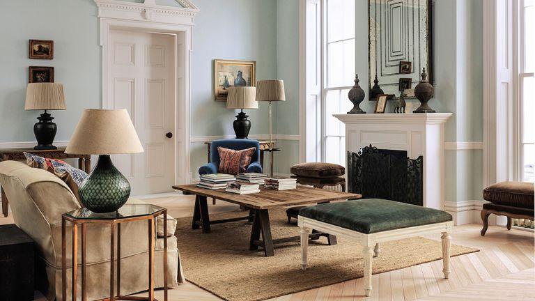 Elegant living room with pale mint walls and vintage furniture