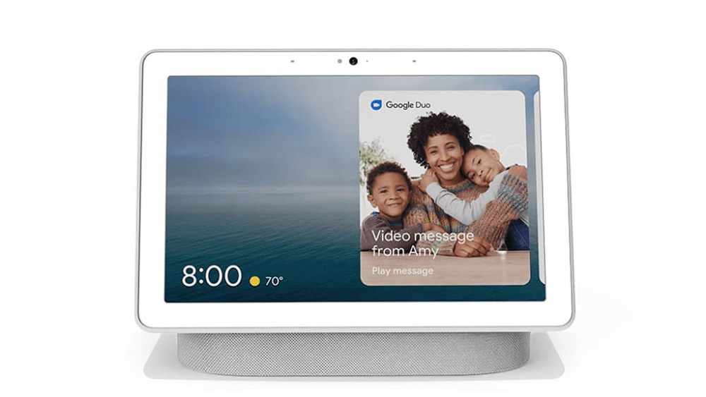 the google nest hub max smart display showing a photo of a smiling family