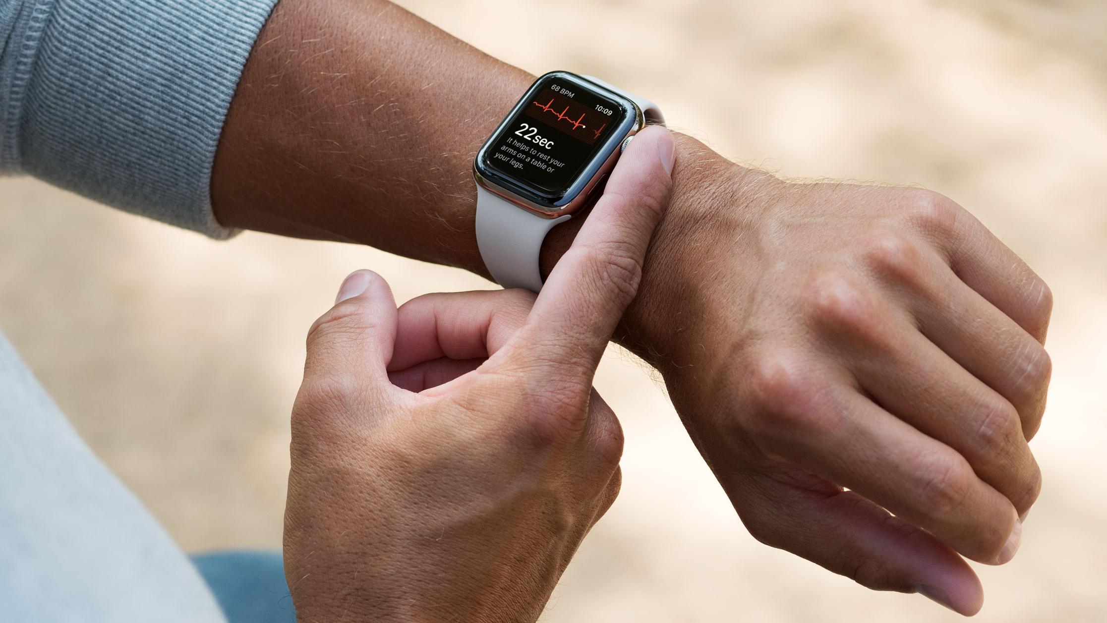 Person wearing Apple Watch, using its ECG app