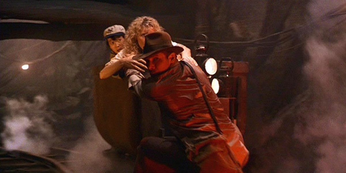 Ke Huy Quan, Kate Capshaw, and Harrison Ford in the mine cart chase from Indiana Jones and the Temple of Doom