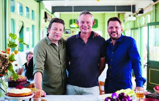 Joining Jamie Oliver and Jimmy Doherty this week is a smiling Martin Clunes, who's no doubt looking forward to being transported back to his childhood holidays by Jamie's take on paella.