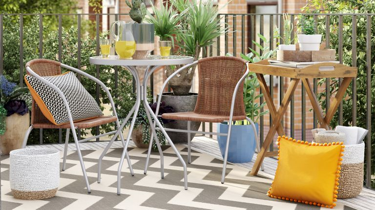garden furniture sales 2 seater bistro set from Wayfair on a balcony