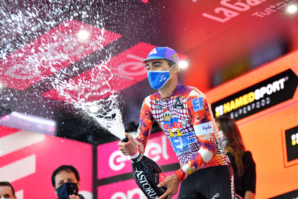 ROCCARASO ITALY OCTOBER 11 Podium Ruben Guerreiro of Portugal and Team EF Pro Cycling Celebration Champagne during the 103rd Giro dItalia 2020 Stage 9 a 207km stage from San Salvo to Roccaraso Aremogna 1658m girodiitalia Giro on October 11 2020 in Roccaraso Italy Photo by Stuart FranklinGetty Images