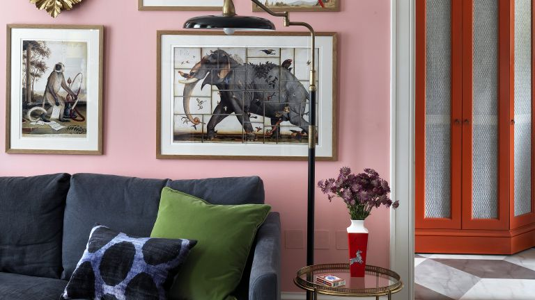 Beata Heuman interior design tips, living room with an art wall and pink paint
