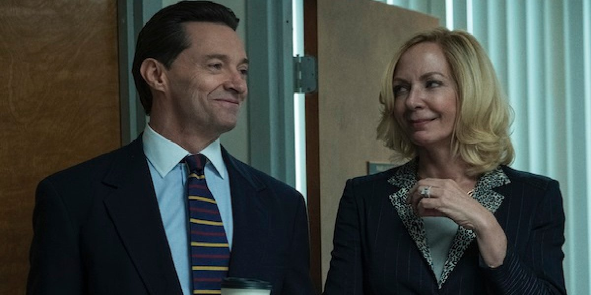 Bad Education Hugh Jackman and Alison Janney stand smiling in their office
