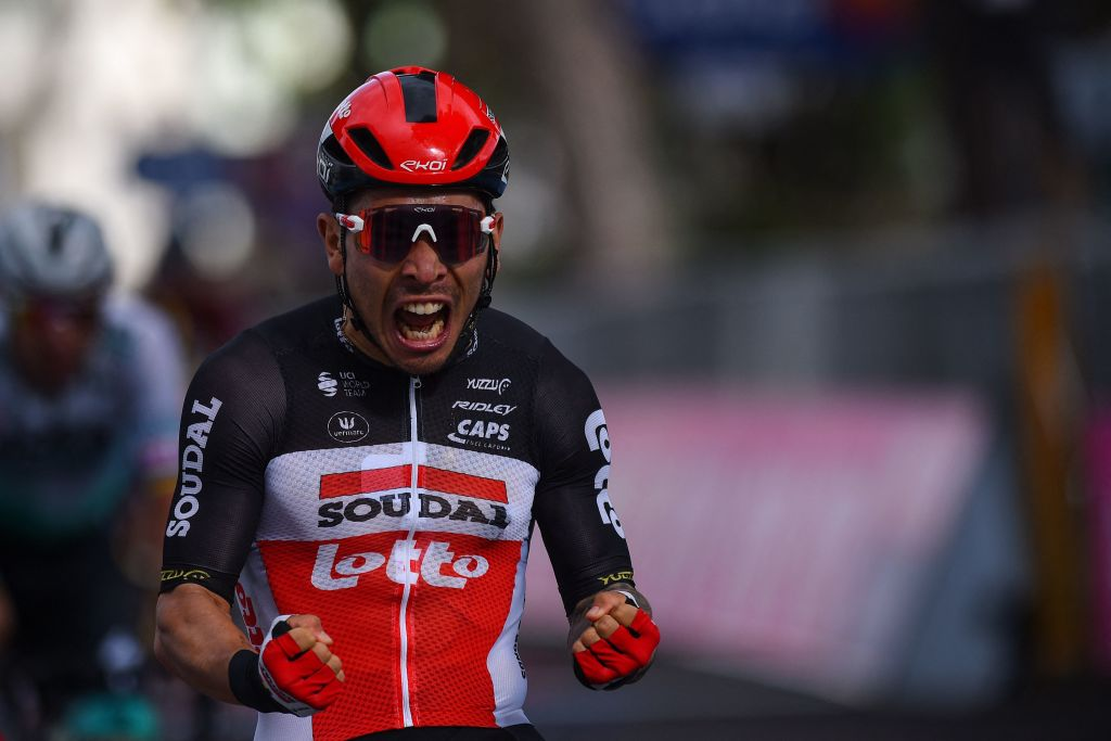TOPSHOT Team LottoSoudal rider Australias Caleb Ewan celebrates on the finish line after winning the fifth stage of the Giro dItalia 2021 cycling race 177 km between Modena and Cattolica EmiliaRomagna on May 12 2021 Photo by Dario BELINGHERI AFP Photo by DARIO BELINGHERIAFP via Getty Images