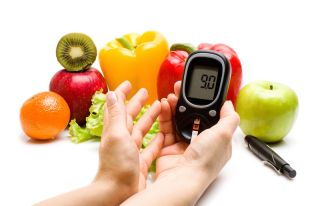 Fruits and vegetables, and a blood sugar monitor.
