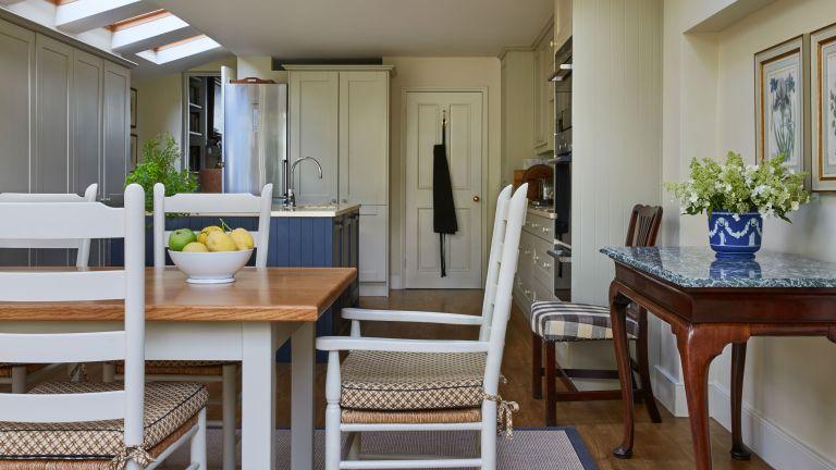 cream kitchen with dark grey blue island