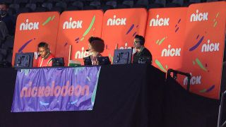 From left, Nate Burleson, Gabrielle Nevaeh Green and Noah Eagle work the Nickelodeon booth for the Saints-Bears playoff game.