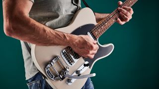 Man plays Telecaster electric guitar with Bigsby vibrato