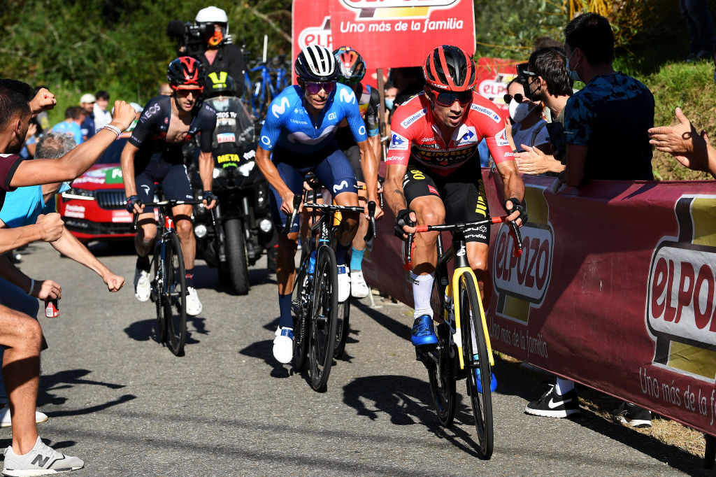 MOS SPAIN SEPTEMBER 04 Primoz Roglic of Slovenia and Team Jumbo Visma red leader jersey competes ahead of Enric Mas Nicolau of Spain and Movistar Team and Adam Yates of United Kingdom and Team INEOS Grenadiers in the chase group during the 76th Tour of Spain 2021 Stage 20 a 2022km km stage from Sanxenxo to Mos Alto Castro de Herville 502m lavuelta LaVuelta21 on September 04 2021 in Mos Spain Photo by Tim de WaeleGetty Images