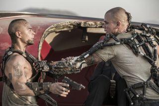 Matt Damon (right) and Jose Pablo Cantillo in Columbia Pictures' 'Elysium'