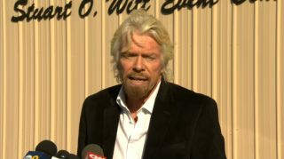 Virgin Galactic founder Sir Richard Branson makes a brief statement to media at the Mojave Air and Space Port on Nov. 1, one day after the company's SpaceShipTwo spacecraft crashed during a test flight. One pilot died in the crash, while another was injur