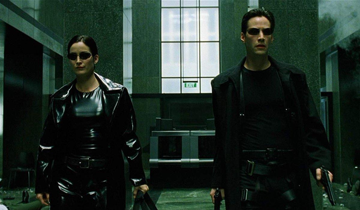 The Matrix Trinity and Neo walk through the lobby