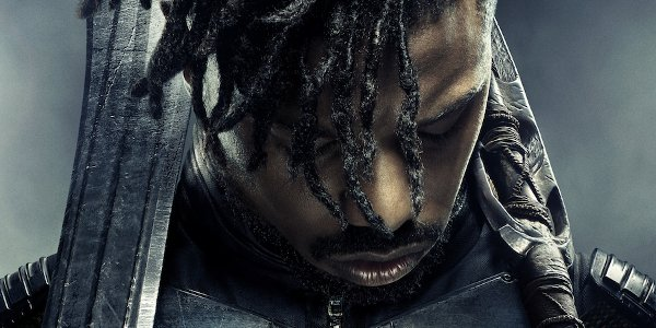 Black Panther Michael B. Jordan Killmonger solemn pose with weapons