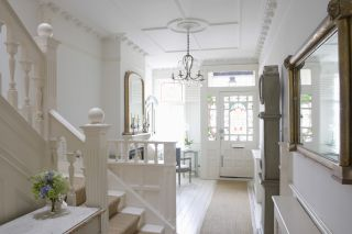 Period home hallway with plaster moulding and cornices