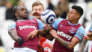 How to watch West Ham United in the Premier League - Michail Antonio (L) and Jesse Lingard jump for the ball in May 2021.