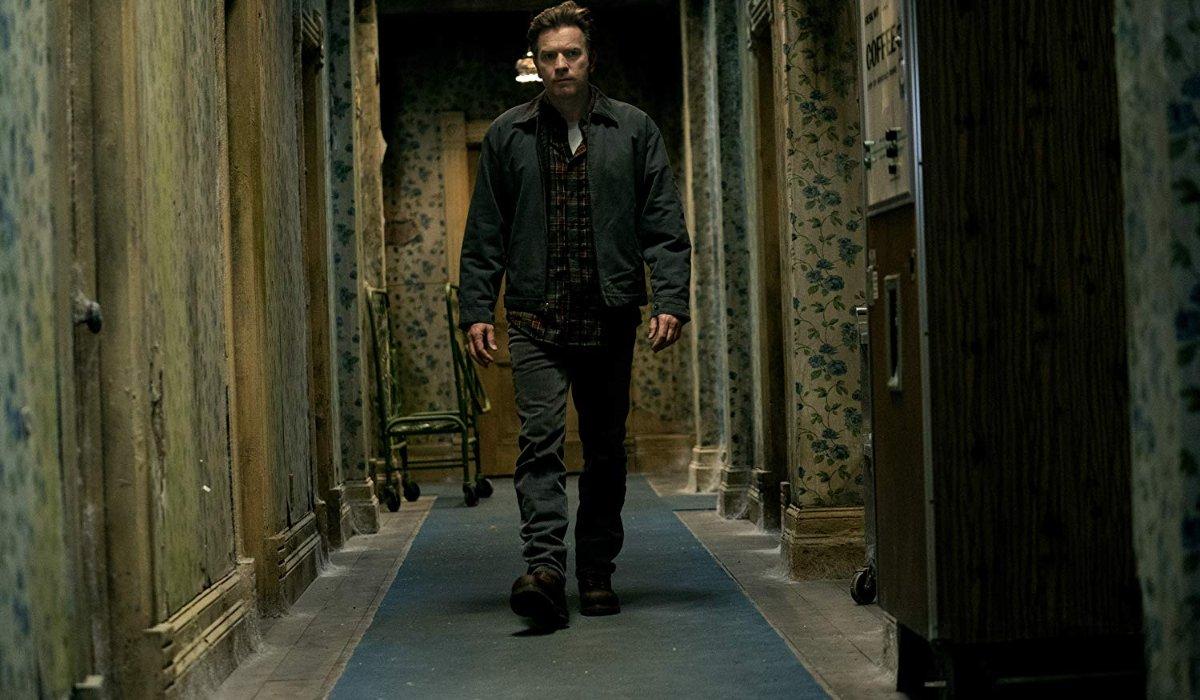 Doctor Sleep Danny Torrance walking down an Overlook hallway