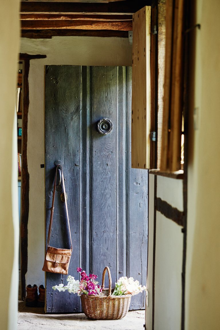 wooden front door in 17th century cottage