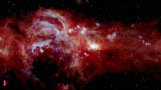 A composite image shows infrared light from swirls of gas and dust at the center of the Milky Way.