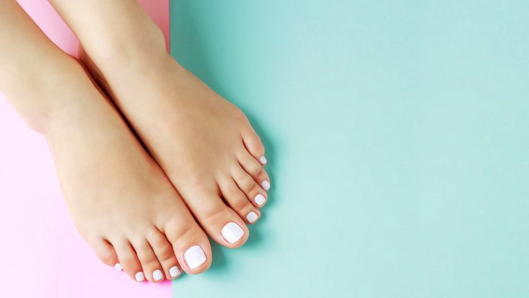 Home pedicure on blue and pink background