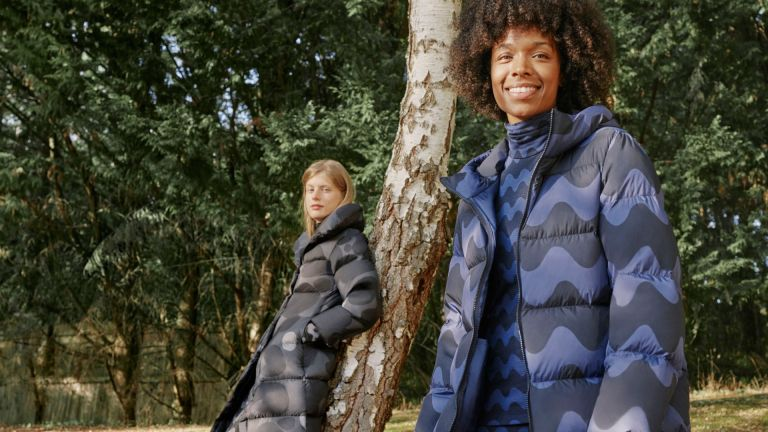 models wearing Uniqlo x Marimekko coats in woodland