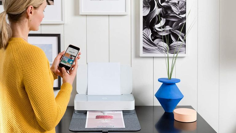 best small printer: HP Tango X on side table with woman printing from mobile