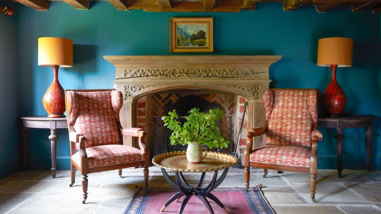 A colorful living room in a country home in Sussex designed by Kate Forman