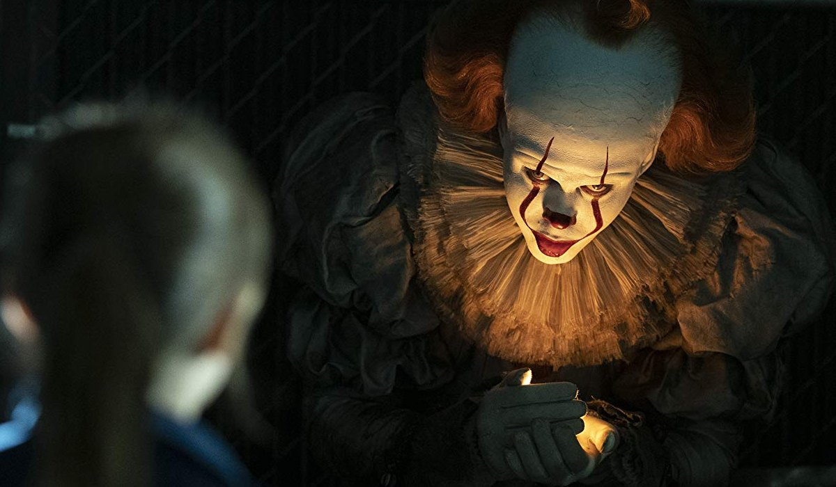 It Chapter Two Pennywise holds the flame in the bleachers