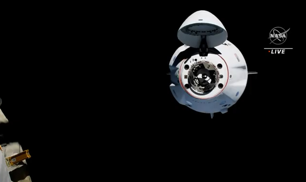 SpaceX's Crew-2 Crew Dragon Endeavour arrives at the International Space Station with four astronauts aboard in a smooth docking on April 24, 2021 one day after launching into orbit.
