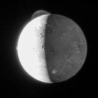 A 180-mile-high plume of the volcano near Io's north pole.
