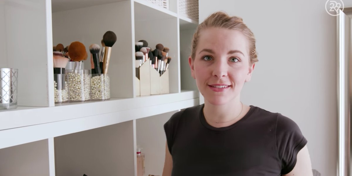 Bea in a client's room organizing their makeup brushes.