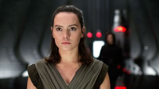 Daisy Ridley as Rey in front of an out-of-focus Kylo Ren in Star Wars: The Last Jedi