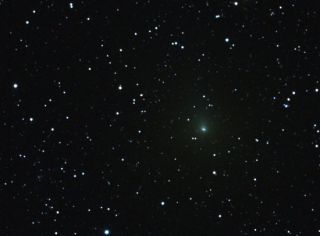 Comet Hartley 2 is captured in this photograph from 18 million miles from Earth.