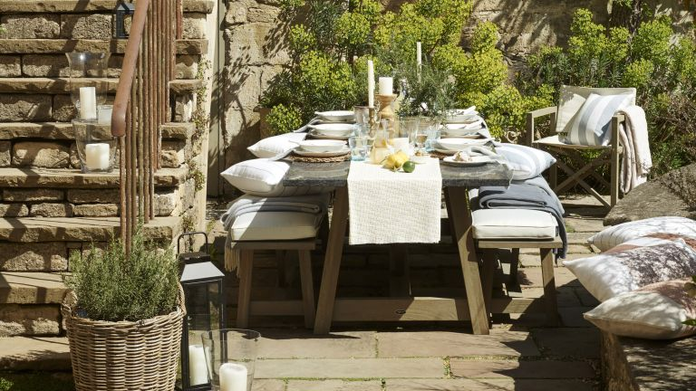 outdoor dining space on a sunny courtyard patio