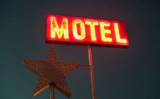 Neon sign proclaiming 'MOTEL'.