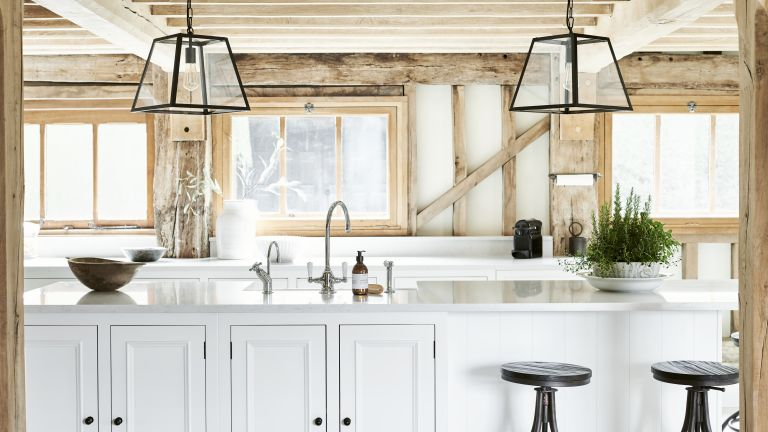 Prep sinks kitchen trend in a country-style kitchen with wooden beams
