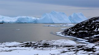 Icebergs near Greenland form from ice that has broken off--or calved--from glaciers on the island.