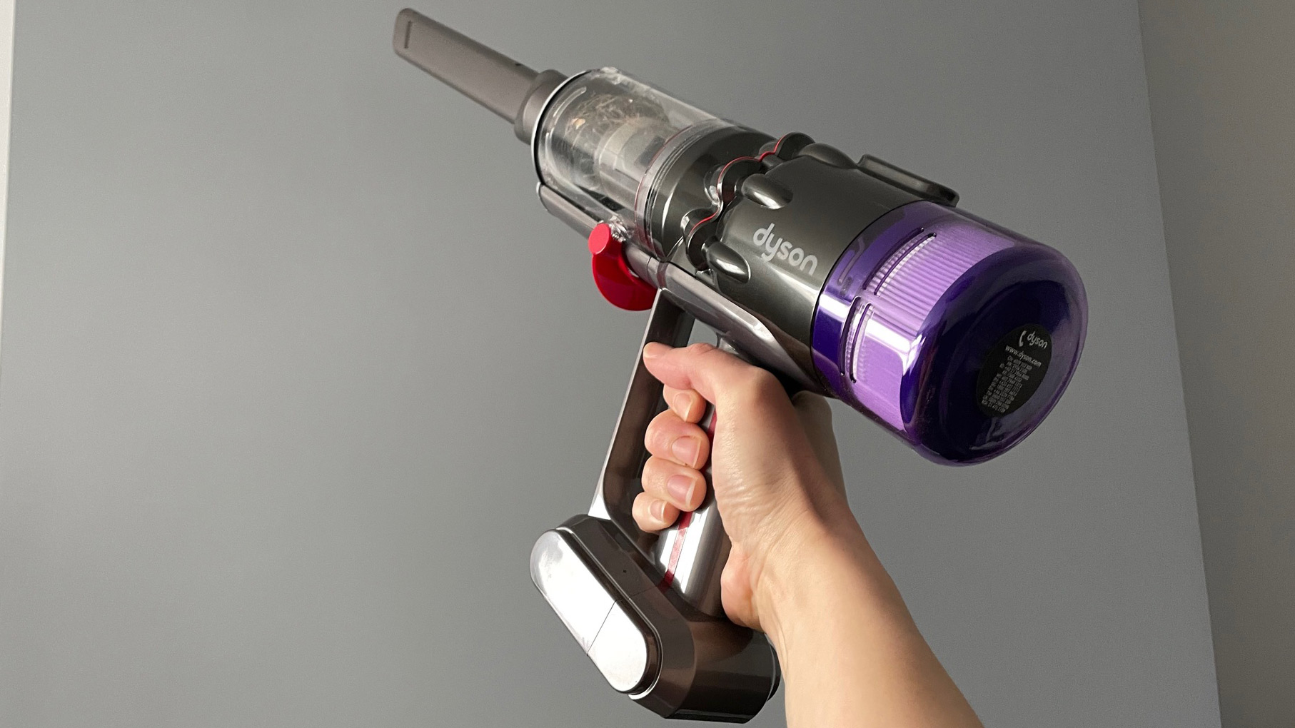 Dyson Micro 1.5kg being used as a handheld vacuum cleaner to clean up high