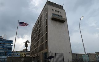 The American flag flies outside the U.S. Embassy on Oct. 14, 2017, in Havana, Cuba.