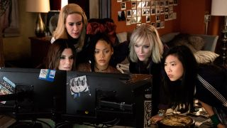 An image from Ocean's 8 where they print a necklace