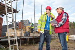 builders on a home construction site