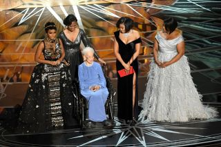 "NASA mathematician Katherine Johnson (second left) is honored onstage with actors (left to right) Janelle Monae, Taraji P. Henson and Octavia Spencer - the stars of ""Hidden Figures,"" which focuses on Johnson's work with NASA's Mercury program - during the"