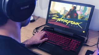 person using a gaming laptop