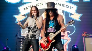 Slash and Myles Kennedy performing live
