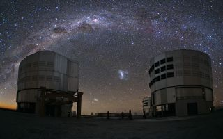 Magellanic Clouds Over Paranal 1920