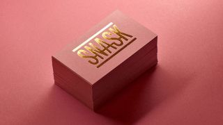 Pink and gold business cards with Snask logo