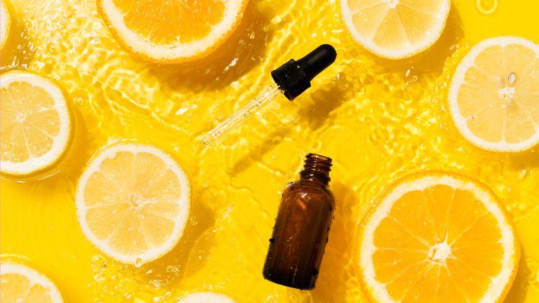 bottle of serum on orange slices