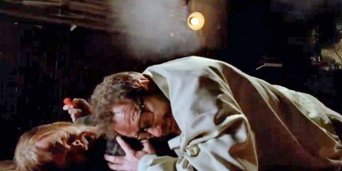 Walt protecting Jesse on the ground in Breaking Bad.